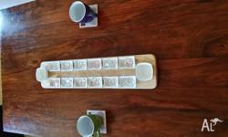 This Mancala board game is comprised of 14 ceramic