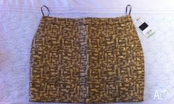 Never worn gold mini skirt with black detailing from