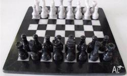 Modeled on the famous Staunton Chess sets this black