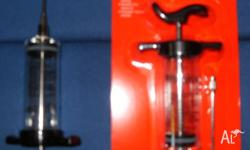 Up for sale is 2 Marinade Injector ( One NEW one Used)