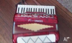 PIANO ACCORDIAN FOR SALE IS A MAINUCCI MILITARSTR.22 is