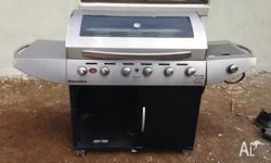 6 Burner BBQ matador brand. Works perfectly. Has side