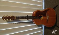 This is a beautiful old 12 string Maton FG150