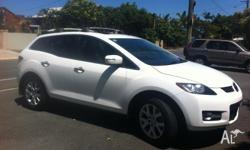 We are selling our Automatic Mazda CX-7 in White. The