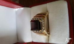 Mens 9ct gold ring with large red stone and eight