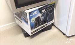 Stainless Steel Micrwave and JVC UX-LP5 Stereo With 4