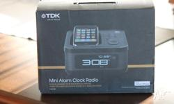 UNWANTED PRIZE! TDK Mini alarm clock radio. Never used