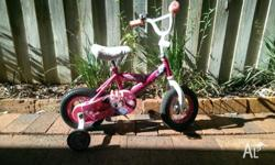 Great little bike, has training wheels, bell, and