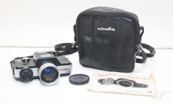 Up for grabs is this tiny little Minolta 110 Zoom SLR