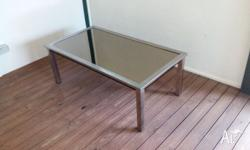 Coffee Table with mirror top and is extendable.