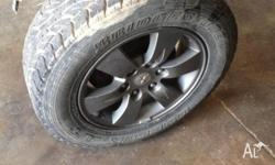 Triton 17 inch glxr rims set of 5. 50 percent tread.