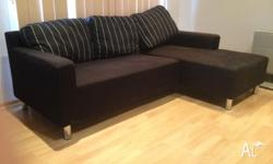 L shaped couch with matching cushions that can be