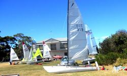A Mosquito Catamaran is a one design 5m (16ft) racing
