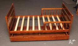 Mothers Choice toddler bed with built in drawer. Teak.