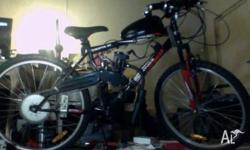 Motorised 18 Speed Mountain Bike for sale. 2 months old