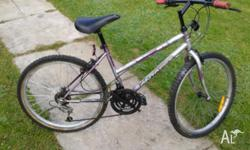 FOR SALE IS MY MOUNTAIN BIKE IN GOOD WORKING