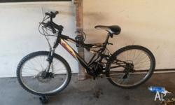 Second hand Mountain Bike + Helmet for sale. Rides