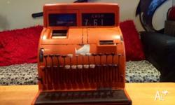 Vintage National cash register in good condition.
