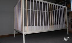 White wooden cot 1250cm x 700cm with 9cm deep mattress,