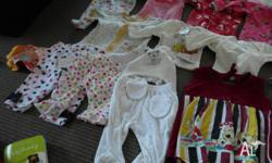 Various baby clothes from new born to nine months. Some