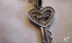 100% Autentic. Brand New. Comes in original box DKNY