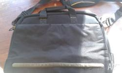 Laptop bag. Paid quite a bit. Never got used as one
