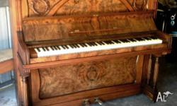 This is a nice Mignon upright iron frame piano that I