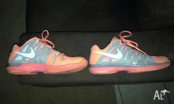For sale is a pair of Nike Vapor tennis shoes. In used