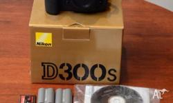 Nikon D300s camera body plus 2 genuine Nikon batteries,