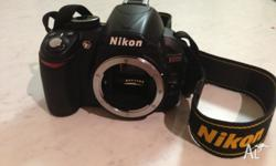 "Nikon digital DSLR D3100 camera body,14.2 MP, 3"" LCD."