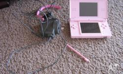 Pink coloured Nintendo DS Lite, includes stylus and