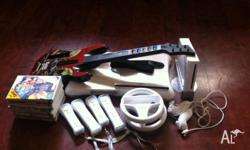 Nintendo WII with games and accesories to suit. WII Fit