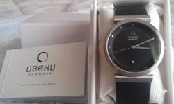 Obaku unisex watch with black 3 1/4cm face and black