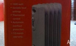 Heaters - 2 off, 30 each, used, Brio brand oil heater,