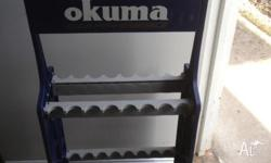 Okuma fishing rod holder stand holds 16 rods. Pick up