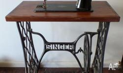 Old Singer Sewing Machine and Base This is a decorative