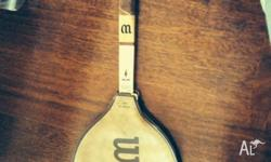 We have for sale an old / collect able wooden racquet.