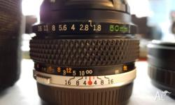 Selling my Olympus 50mm f1.8 lens with adapters. It's