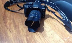 Olympus slr digital camera Black in colour Included