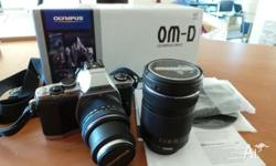 OLYMPUS OMD EM 5 - AS NEW WITH 2 LENSES ALL WITH BOXES