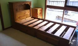 Single size pine timber bed.Bed head with storage