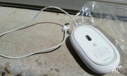 Optical apple mouse. Includes scroll tiny ball for your