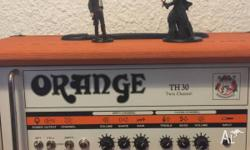 The all-tube Orange TH30 guitar amp head offers a