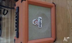 Orange Crush 10 amplifier. Shows signs of use, one of