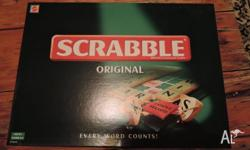 - Original Scrabble board game - Opened but never used