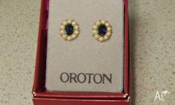 Oroton Earrings dark blue center stone surrounded by
