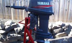 Used, 1999 Yamaha two stroke tiller outboard motor,