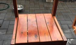 Outdoor chairs that were sanded and glossed. 2 chairs