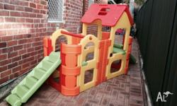 Outdoor climbing frame with undercover area including