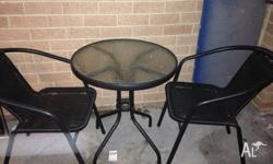 2 seater outdoor setting Glass table top. Wicker chairs